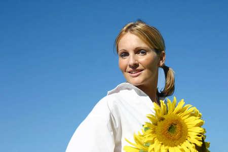 Beautiful Sunflower Woman and a blue sky. photo