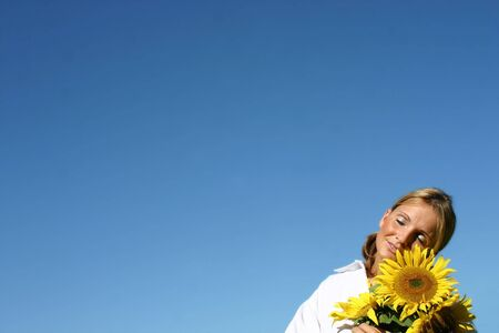 Beautiful Sunflower Woman and a blue sky. Stock Photo - 893271