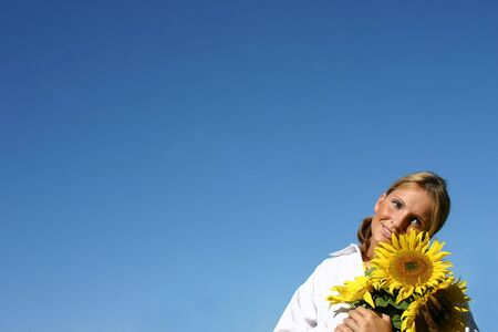 Beautiful Sunflower Woman and a blue sky. Stock Photo - 893272