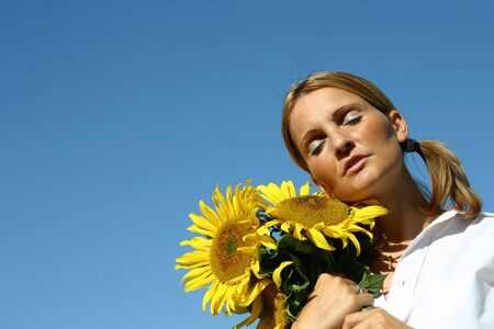 Beautiful Sunflower Woman and a blue sky. Stock Photo - 893273