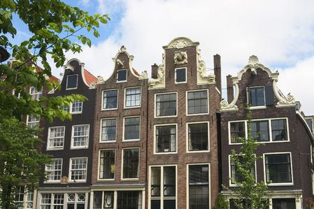 dutch canal house: amsterdam canal houses with typical dutch fronts Stock Photo