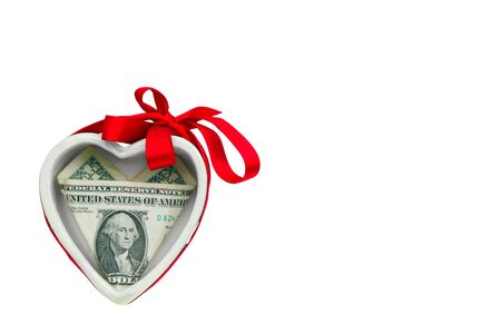 Ceramic heart with a dollar bill inside, isolated on white