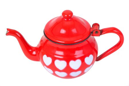 Red vintage teapot with painted hearts, isolated on white