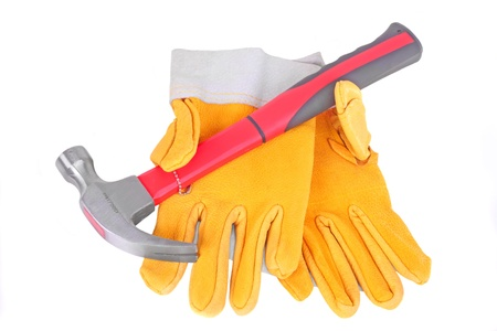 Hammer and pair of yellow protective gloves, isolated on white Stock Photo