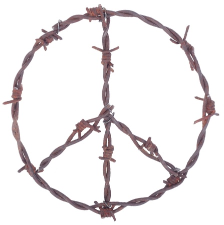 Rusty barbed wire peace sign isolated on white photo