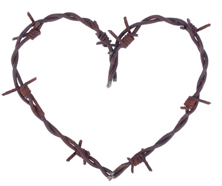 Rusty barbed wire heart isolated on white