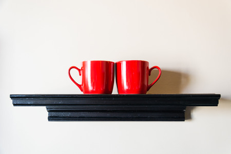 couple red cup on wall photo