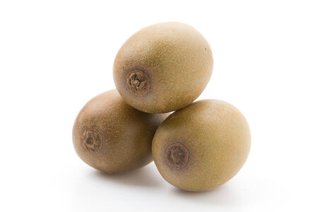 Golden Kiwi fruit isolated on white background photo