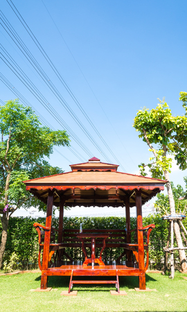 wood pavilion in the garden photo