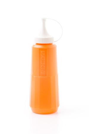 bottle of chili sauce isolated photo