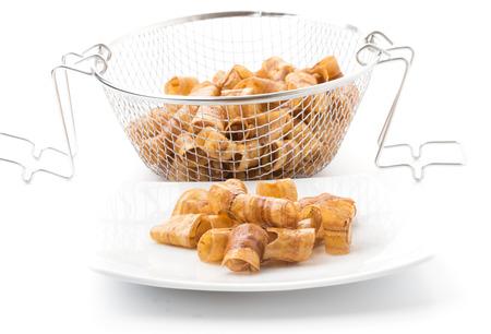 fryer: banana rolls in deep fryer Stock Photo