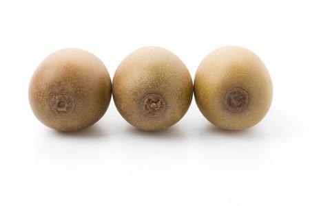golden section: Golden Kiwi fruits isolated on white background