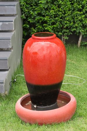 earthen: red earthen jar on glass