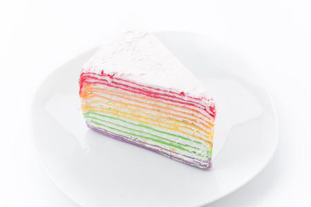 Rainbow crepe cake isolated on white background photo
