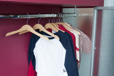 closet rod: wood hangers with kid clothes