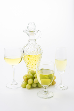cheeseboard: white wine and grapes isolated