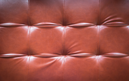 red leather sofa background photo