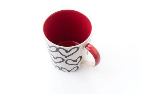 decaffeinated: White mug with heart pattern Stock Photo