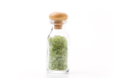tsavorite: peridot in glass bottle isolated on white background Stock Photo