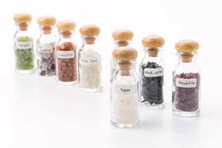 topaz: topaz in glass bottle isolated