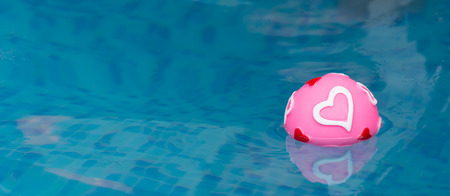 pink heart ball in pool Stock Photo