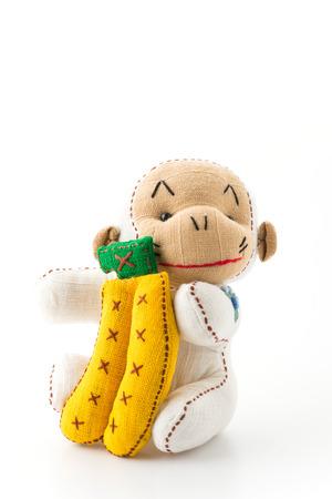 huggable: monkey doll with banana on white background Stock Photo