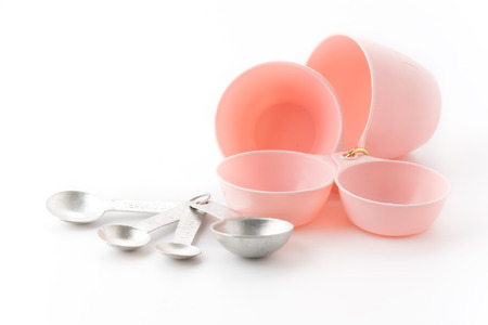 Measuring spoon and cup on white background photo