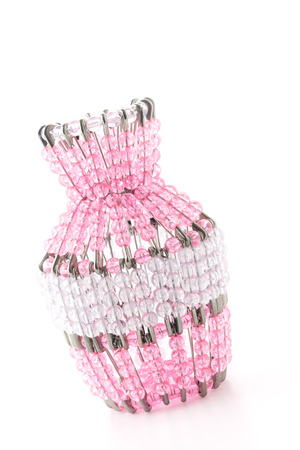 Bead woven vase isolated on white background photo