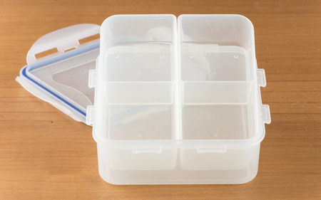 tupperware: Food containers on wood table