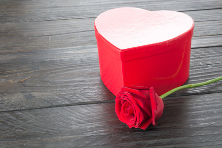 heart gift box: red rose and heart gift box on wood background
