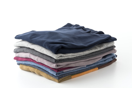 shirts: Stack of clothes isolated on white background Stock Photo