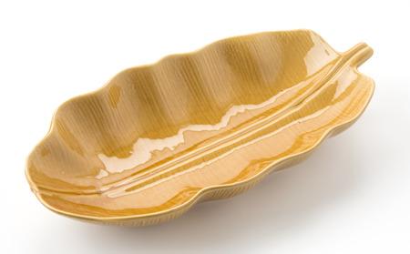 leaf shape: brown leaf shape dish on white