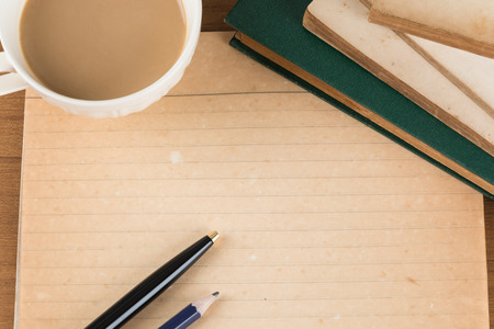antique books: old notebook with pen on wood table