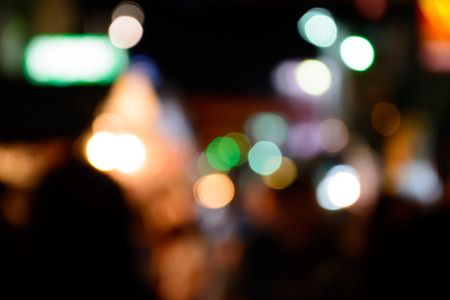 dark city: blured lighhts bokeh for background from walking street in Hua Hin, Thailand.