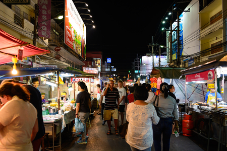 stroll: HUA HIN, THAILAND - FEB 02 2015: Tourists stroll at the night market in Hua Hin. The famous night market in Hua Hin is a major tourist attraction.