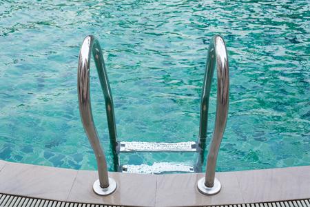 grab: Grab bars ladder in the pool.