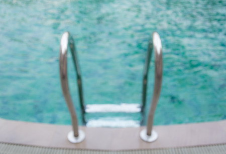 grab: Grab bars ladder in the pool.Blur for background Stock Photo