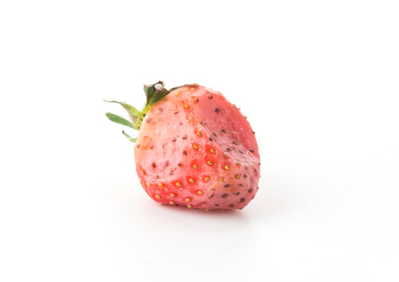 uneatable: strawberry be moldy on white