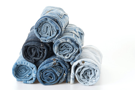 jeans: Stack of jeans on white  Stock Photo