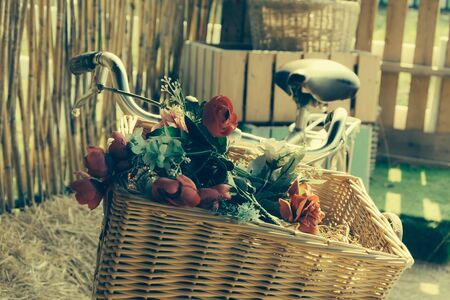 decorated bike: bicycle with basket flower -soft focus with vintage film filter