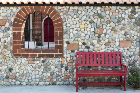 window bench: red bench with wall and window Stock Photo