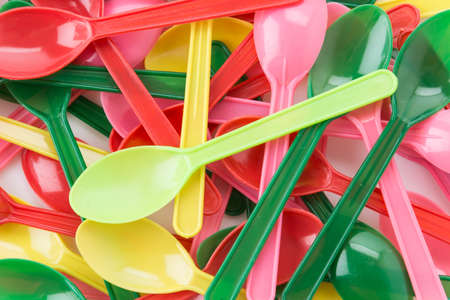 baby cutlery: plastic spoon on white background Stock Photo