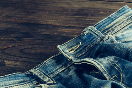 cotton  jeans: jean on wood - soft focus with vintage film filter Stock Photo