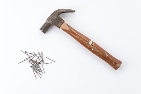 hammer and nails: hammer and nail with wood Stock Photo