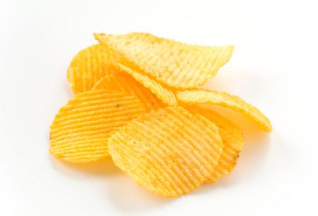 prepared potato: potato chips on white background