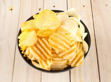 nosh: potato chips on wood background Stock Photo