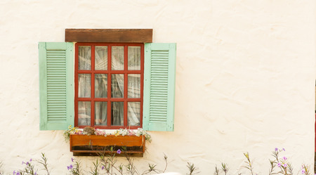 white window: vintage window on white wall - soft focus with vintage filter Stock Photo