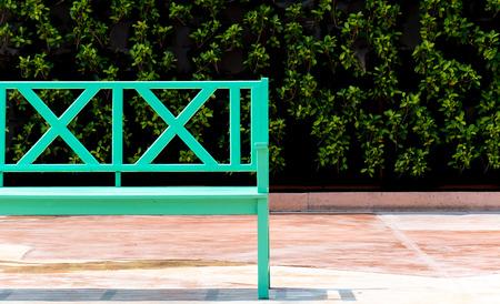 garden lawn: green bench with park background