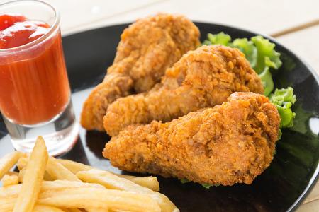 junk food: fried crispy chicken on wood Stock Photo