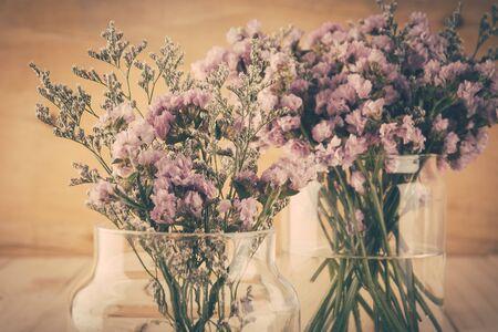 dried flower arrangement: statice flower bouquet  on wood background